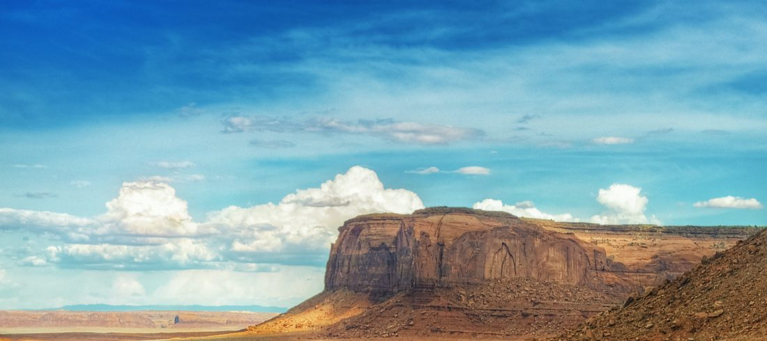 Photo of desert field, rocky plateau and endless, cloud-filled sky so gorgeous it looks painted