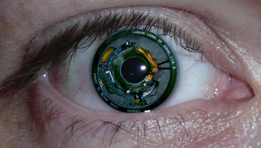 Photoshopped image of a Canon lens grafted into an eye. Creepy, but arguably helpful for this photographer.